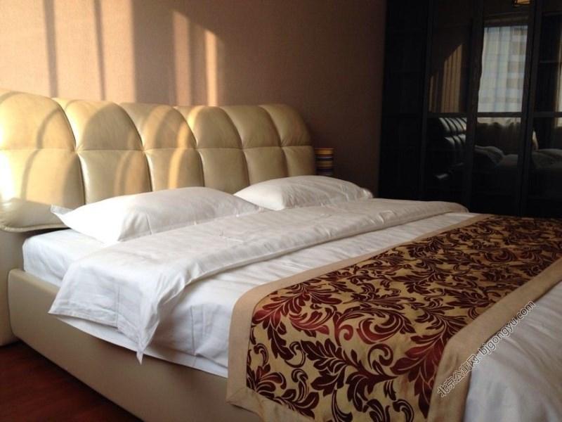 华远九都汇酒店式公寓卧室